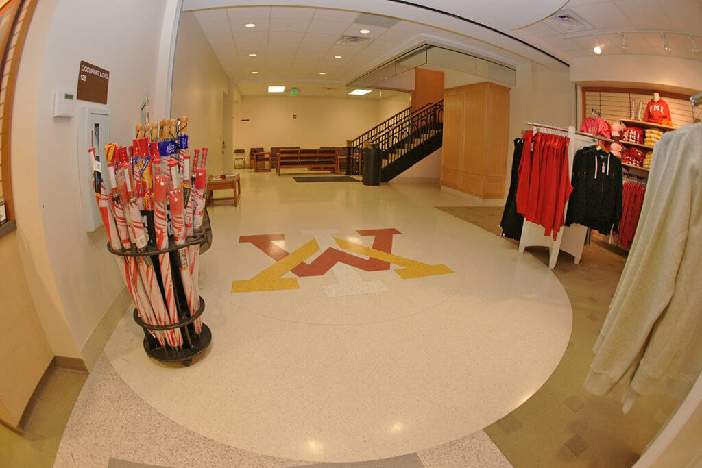 Retail Store with Epoxy Terrazzo Logo at Entrance of Building