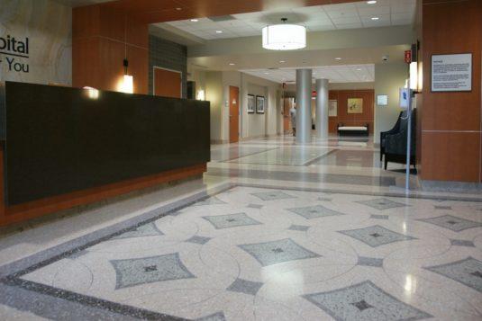 Geometric terrazzo floor design at entrance of hospital clinic